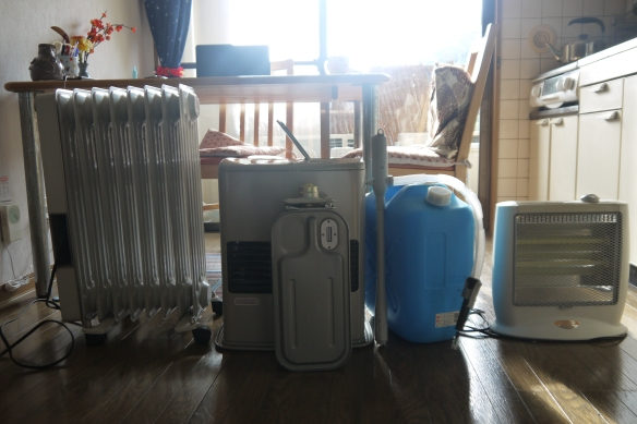 My three heaters: an oil heater, the kerosene heater and a small electric one (from right)