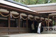 A Shinto priest demonstrating how to bow to a shrine