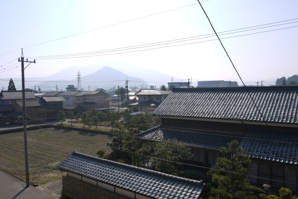 Mount Hino is obscured by the sunny, polluted and pollunated haze