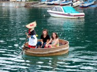 Taking a ride in the traditional bath-tub boat on Sado Island